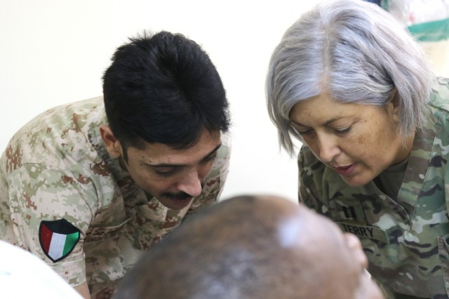 U.S. Army Capt. Theresa Terry, 349th Combat Support hospital, demonstrates the application of a tourniquet to a Kuwait Army nurse at Camp Arifjan's U.S. Military Hospital - Kuwait June 17, 2019. (U.S. Army National Guard photo by Sgt. Connie Jones)