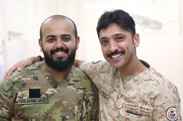 Abdul Rahman Shabeeb and Awadh Hamoud, Kuwait Army nurses, visit Camp Arifjan's U.S. Military Hospital - Kuwait June 17, 2019. (U.S. Army National Guard photo by Sgt. Connie Jones)