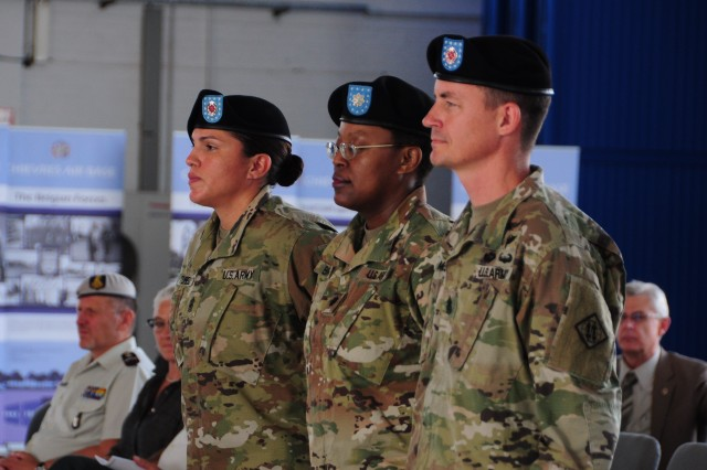 From left to right: Army Command Sgt. Maj. Carolyn Turell, Army Lt. Col. Ericka Brooks, and Army Command Sgt. Maj. Timothy McGuire stand at attention during the 39th Strategic Signal Battalion's Change of Responsibility ceremony June 25, 2019, at Chievres Air Base, Belgium. McGuire transferred responsibility to Turell during the ceremony.