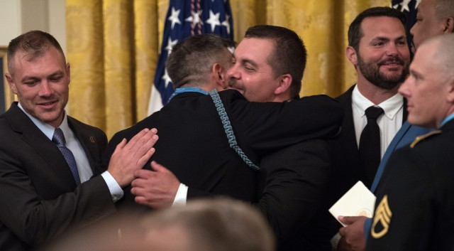 Teammates congratulate Medal of Honor recipient