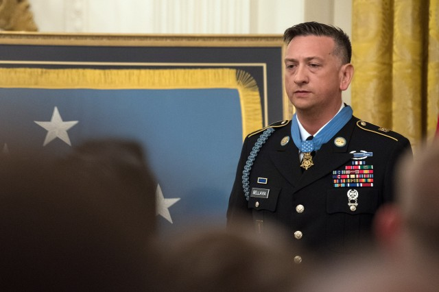 The crowd applauds former Staff Sgt. David Bellavia after he received the Medal of Honor at the White House, June 25, 2019.