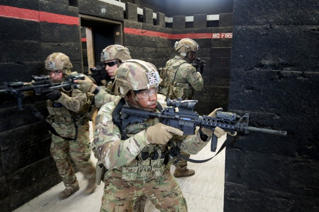 Advisor from 3rd Security Force Assistance Brigade clear a building of security threats at the House Creek Shoot-House during unit training at Fort Hood, Texas on 11 June 2019. The logistics and combat team Soldiers conducted key leader engagement security training to prepare themselves with the proper tactics to engage and defeat any security threat.