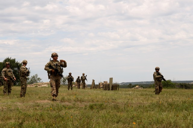 Advisor from 3rd Security Force Assistance Brigade move to a building to conduct a key leader engagement at the House Creek Assault Course during unit training at Fort Hood, Texas on 11 June 2019. The logistics and combat team Soldiers conducted movement training to a key leader engagement where they had to react to indirect-fire and assess and move a casualty.