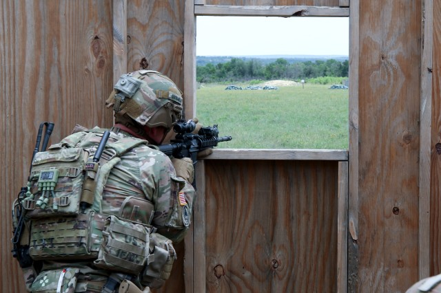 A 3rd Security Force Assistance Brigade Advisor conducts perimeter security after receiving indirect-fire at the House Creek Assault Course during unit training at Fort Hood, Texas on 11 June 2019. The logistics and combat team Soldiers secured their position before assessing a casualty and moving to their vehicle for medical evacuation.
