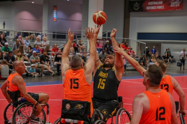U.S. Army retired Capt. Alex Wilson takes a shot during a wheelchair basketball preliminary game, June 24, 2019, at The Tampa Convention Center during the 2019 Department of Defense Warrior Games. The DoD Warrior Games are being are conducted June 21-30, and hosted by Special Operations Command, Tampa, Florida. It is an adaptive sports competition for wounded, ill, and injured service members and veterans. Approximately 300 athletes repesenting teams from the U.S. Army, Marine Corps, Navy, Air Force, Special Operations Command, United Kingdom Armed Forces, Australian Defence Forces, Canadian Armed Forces, Armed Forces of the Netherlands, and the Danish Armed Forces will compete in archery, cycling, shooting,sitting volleyball, swimming, track, field, wheelchair basketball, indoor rowing, powerlifting, and for the first time in Warrior Games history, golf, wheelchair tennis, and wheelchair rugby. (U.S Army photo by PFC Dominique Dixon)