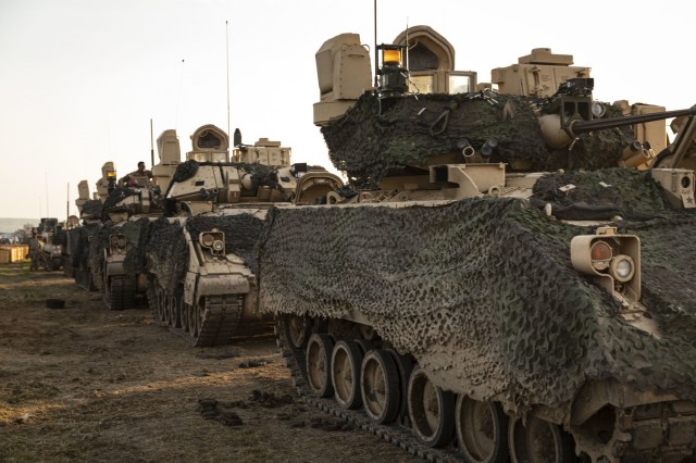 Bradley Fighting Vehicles assigned to the 1st Battalion, 16th Infantry Regiment, 1st Armored Brigade Combat Team, 1st Infantry Division, are staged and ready in preparation to cross the Danube river during the Wet Gap Crossing, the culminating event for Saber Guardian 2019, June 20, 2019. Exercises such as Saber Guardian 19, continue to increase participating nations' readiness and capacity to conduct full spectrum military operations. They send a clear message that the U.S. and its allies and partners work skillfully together. (U.S. Army photo by Sgt. Thomas Mort)