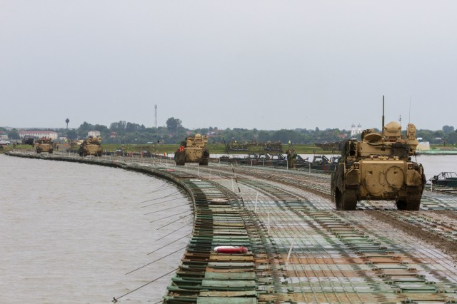 M3 Bradley Fighting Vehicles assigned to 1st Battalion, 16th Infantry Regiment, 1st Armored Brigade Combat Team, 1st Infantry Division cross the Danube river during the culminating exercise of Saber Guardian 19 at Bordusani Romania, June 20, 2019. Saber Guardian 2019 is an exercise co-led by Romanian Land Forces and U.S. Army Europe designed to improve the integration of multinational combat forces. (U.S. Army photo by Staff Sgt. True Thao)