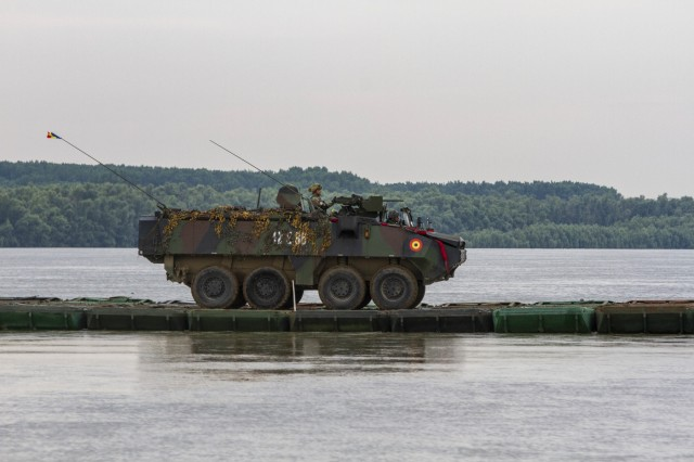 A Romanian Piranha wheel armored vehicle crosses the Danube river during Saber Guardian at Bordusani, Romania, June 20, 2019. Saber Guardian 2019 is an exercise co-led by Romanian Land Forces and U.S. Army Europe designed to improve the integration of multinational combat forces. (U.S. Army photo by Staff Sgt. True Thao)