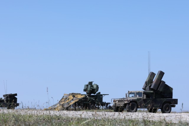 Two AN/TWQ-1 Avenger missile systems from C Battery, 1st Battalion,174th Air Defense Artillery Regiment, pull into position to fire stinger missiles simultaneously as they participate in a Short Range Air Defense Exercise as part of Tobruq Legacy in Utska, Poland, June 17, 2019. Tobruq Legacy is a 21-day exercise that focuses on multi-national partnerships with shared understanding and demonstration of Air Defense capabilities by the United States Army and 11 different partner and allied countries. (U.S. Army photo by Sgt. Kyle Larsen)