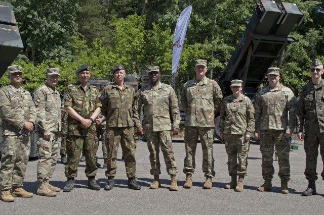 Senior leaders from U.S. and allied partner nations pose for a group photo after receiving briefs on various air defense weaponry during a static display presentation following a Short Range Air Defense Exercise as part of Tobruq Legacy in Utska, Poland, June 17, 2019. Tobruq Legacy is a 21-day exercise that focuses on multi-national partnerships with shared understanding and demonstration of Air Defense capabilities by the United States Army and 11 different partner and allied countries. (U.S. Army photo by Pfc. Caleb Minor)