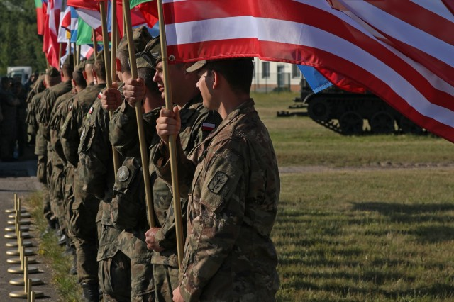 Soldiers from various nations who participated in Tobruq Legacy 19 host their country's national flags at the beginning of the TOLY19 closing ceremony June 19, 2019, in Ustka, Poland. TOLY19 is an annual multinational air defense exercise occurring from June 3-19, 2019, at various locations in Poland. Participating nations include the Czech Republic, Estonia, Germany, Hungary, Latvia, Lithuania, Netherlands, Poland, Romania, Slovakia, Slovenia, the United Kingdom and the United States. (U.S. Army photo by Sgt. Kyle Larsen)