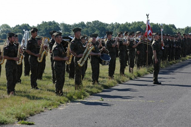 The Polish Army band plays their army song as various nations who participated in Tobruq Legacy 19 stand in formation during the TOLY19 closing ceremony June 19, 2019, in Ustka, Poland. TOLY19 is an annual multinational air defense exercise which included more than 3,000 personnel from 13 nations, to include approximately 300 U.S. military personnel. (U.S. Army photo by Sgt. Kyle Larsen)