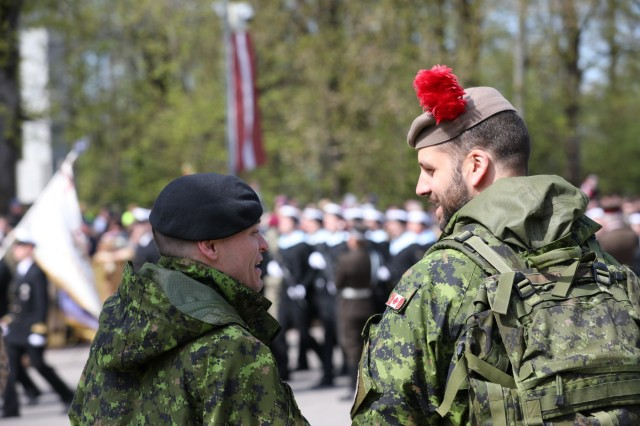 Canadian Soldiers laugh over a conversation during the traditional regional military parade of May 4 in Jekabpils, Latvia, on May 4, 2019. Numerous countries had representatives attend the parade in celebration of the Latvian War for Independence and their Armed Forces. (U.S. Army photo by Sgt. Kyle Larsen)