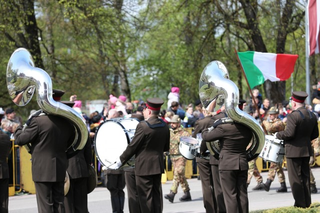 A marching band performs during the traditional regional military parade of May 4 in Jekabpils, Latvia, on May 4, 2019. This year marks the 100th anniversary of the Latvian War for Independence and their Armed Forces. (U.S. Army photo by Sgt. Kyle Larsen)