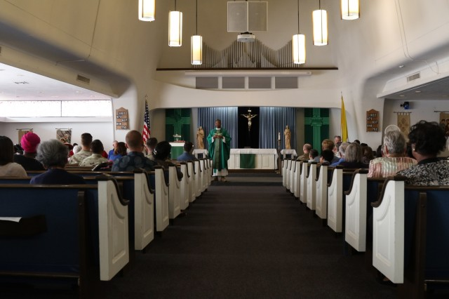 U.S. Army Chaplain, Cpt. Raymond Akirwe, 62nd Engineer Battalion, 36th Engineer Brigade, hosts Sunday's Veteran's Day Catholic mass at the Desert Dove Chapel, Davis-Monthan Air Force Base, Arizona, on Nov. 11, 2018. Soldiers, who are providing military support to the Department of Homeland Security and U.S. Customs and Border Protection to secure the southern border of the United States, were able to get some time off and attend the service. (U.S. Army photo by Sgt. Kyle Larsen)