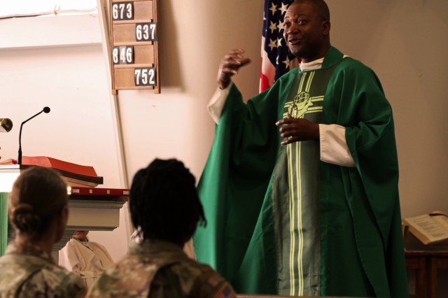 U.S. Army Chaplain, Cpt. Raymond Akirwe, 62nd Engineer Battalion, 36th Engineer Brigade, relates his life lessons to the lessons of God during Sunday's Veteran's Day Catholic mass at the Desert Dove Chapel, Davis-Monthan Air Force Base, Arizona, on Nov. 11, 2018. Soldiers deployed to Arizona are providing military support to the Department of Homeland Security and U.S. Customs and Border Protection to secure the southern border of the United States and were able to get some time off to attend the service. (U.S. Army photo by Sgt. Kyle Larsen)