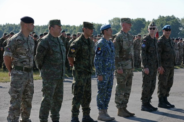Polish leadership recognize top ranking Soldiers from various nations who participated in Tobruq Legacy 19 at the closing ceremony June 19, 2019, in Ustka, Poland. The purpose of the exercise was to improve interoperability with NATO forces through the integration of land component air missile defense capabilities to execute international air missile defense protection of defined defended assets. (U.S. Army photo by Sgt. Kyle Larsen)