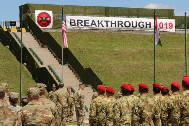 Soldiers from the 2nd Cavalry Regiment, Rose Barracks, Vilseck, Germany, salute the raising of the American flag during the opening ceremony of Breakthrough 2019, June 3, 2019, in the vicinity of Várpalota, Hungary. Breakthrough 2019 is a joint training exercise between the United States Army and Hungarian Defense Forces.