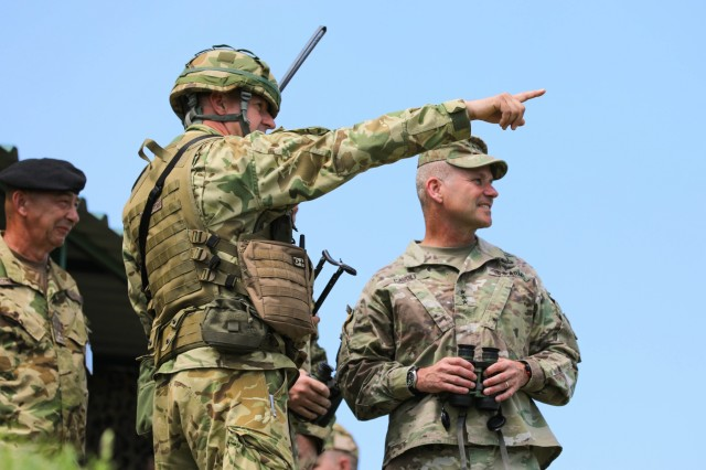 U.S. Army Lt. General Christopher Cavoli, commander, U.S. Army Europe, receives a briefing from Hungarian Defense Forces Col. Vokla Janos (left), commander, Bakony Combat Training Centre while observing a live-fire exercise as part of Breakthrough 2019, Koroshegy Hill, Hungary, June 12, 2019. Breakthrough 2019 demonstrates the ability of the U.S. Army to conduct combined field artillery operations with the Hungarian Defense Forces in order to build interoperability and collective readiness.