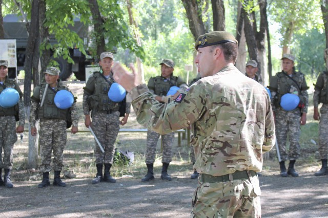British Army Sgt. Rob Walisko, a soldier with the 3rd Battalion of the Princess of Wales' Royal Regiment and the lead instructor for the public order training at Exercise Steppe Eagle 19, instructs Kazakhstani soldiers how to properly maneuver in a crowd control scenario, June 20, 2019, as part of Exercise Steppe Eagle 19 at Chilikemer Training Area near Almaty, Kazakhstan. The exercise is an annual U.S. Army Central-led exercise that promotes regional stability and interoperability in the Central and South Asia region. (Photo by U.S. Army Maj. Kevin Sandell)