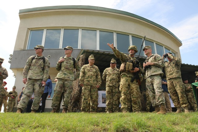 U.S. Army Lt. General Christopher Cavoli, commander, U.S. Army Europe, receives a briefing from Hungarian Defense Forces Col. Vokla Janos, commander, Bakony Combat Training Centre, while observing a live fire exercise during Breakthrough 2019, Koroshegy Hill, Hungary, June 12, 2019. Breakthrough 2019 demonstrates the ability of the U.S. Army to conduct combined field artillery operations with the Hungarian Defense Forces in order to build interoperability and collective readiness.