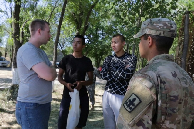 CHILIKEMER TRAINING AREA, Kazakhstan (June 26, 2019) --  Spc. Levi Madsen (far left), Utah Army National Guard, interprets for a soldier at Exercise Steppe Eagle 19 at Chilikemer Training Area near Almaty, Kazakhstan, June 25, 2019. Kazakhstan, the United States, the United Kingdom, Tajikistan, and Kyrgyzstan all sent participants for the exercise, while India, Turkey, and Uzbekistan sent observers. Steppe Eagle 19 is an annual U.S. Army Central-led exercise that promotes regional stability and interoperability in the Central and South Asia region. (U.S. Army photo by Staff Sgt. Adrian Borunda)