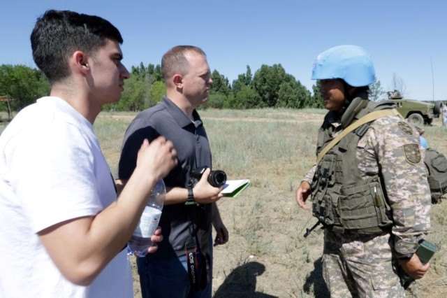 CHILIKEMER TRAINING AREA, Kazakhstan (June 26, 2019) --  Spc. Gregory Thomson (far left), Utah Army National Guard, interprets for a media role player during cordon and search training with the Kazakhstani Ground Forces at Exercise Steppe Eagle 19 at Chilikemer Training Area near Almaty, Kazakhstan, June 25, 2019. Kazakhstan, the United States, the United Kingdom, Tajikistan, and Kyrgyzstan all sent participants for the exercise, while India, Turkey, and Uzbekistan sent observers. Steppe Eagle 19 is an annual U.S. Army Central-led exercise that promotes regional stability and interoperability in the Central and South Asia region. (U.S. Army photo by Staff Sgt. Adrian Borunda)