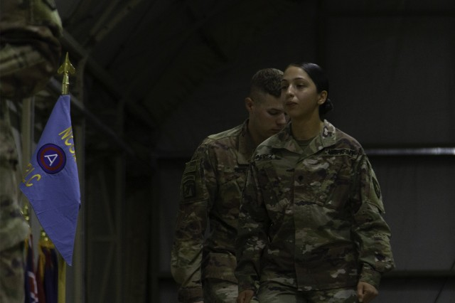 Spc. Mia Perez, Special Troops Battalion, 300th Sustainment Brigade, walks across the U.S. Army Basic Leader Course graduation stage at Camp Buehring, June 8, 2019. (U.S. Army Reserve photo by Capt. Jerry Duong)