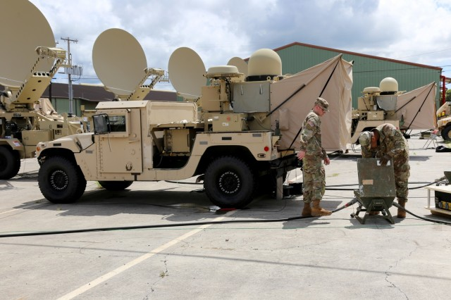 """Soldiers from the 3rd Brigade Combat Team, 25th ID train on a Tactical Communication Node - Lite (TCN Lite) at Schofield Barracks, Hawaii, in September 2018. """"We need reliable access to network services to enable the commander to make decisions based on information across every warfighting function,"""" said Lt. Col. Malcom Bush, assistant chief of staff, G-6 for the 25th ID, and on-the-move tactical network equipment like the TCN Lite increases the unit's survivability. (U.S. Army photo by Amy Walker, PM Tactical Network/PEO C3T Public Affairs)"""