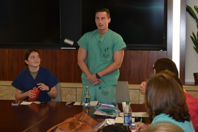Cadet Katherine Keady, Georgetown University, and Cadet Joshua Nixon, University of North Georgia, share their experiences as interns in the Nurse Summer Training Program with university officials at Brooke Army Medical Center.