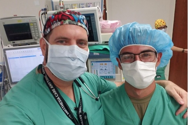 Cadet Vincent Piserchia (right) from Carson-Newman University shadowed Brad West, Certified Registered Nurse Anesthetist, Brooke Army Medical Center, June 21 during an eight hour surgical procedure where a femur and patella were being repaired. West was the first Cadet to attend Carson-Newman University and graduated in 1992.