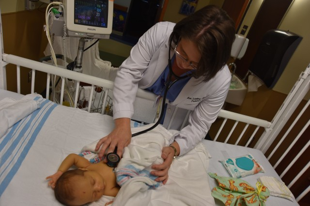 Capt. Ann Schilling examines Eliana Torrealba at Cape Fear Valley Medical Center on June 13.
