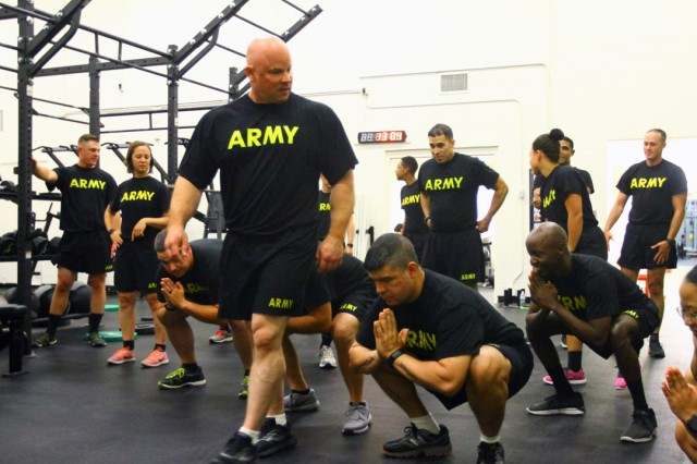 Fitness Advisory Board member Lt. Col. Damon Wells, standing, ensures Soldiers know how to properly squat to perform lifting techniques Jan. 20, 2019, at Goldner Fitness Center. Wells helped create the Performance Enhancement Foundation pilot course.