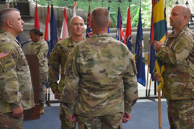 (Pictured from left to right) Brig. Gen. Timothy J. Daugherty, commanding general, USACRC, and director of Army safety, incoming Command Sgt. Maj. William L. Gardner, outgoing Command Sgt. Maj. Ernest D. Bowen Jr., and Master Sgt. Robert A. Brunney prepare to transfer USACRC colors during a Change of Responsibility ceremony at Fort Rucker, June 25.