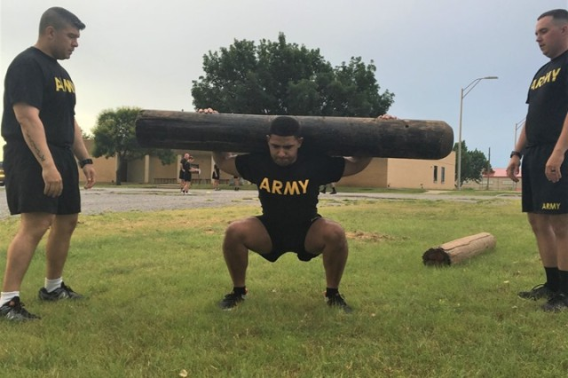 Sgt. McKinley Ward, center, prepares to carry a log as Staff Sgt. Carlos Acosta and Sgt. Matthew McHenry serve as spotters June 18, 2019, outside the Graham Performance Enhancement Center during the pilot course.
