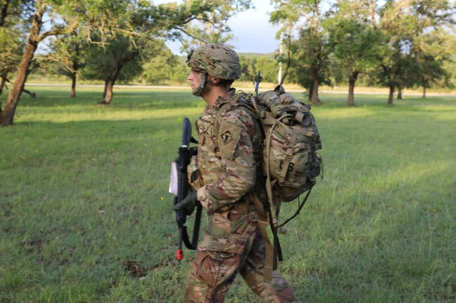 Spec. Jared Lausen prepares for his march to his first lane at the Army Futures Command Best Warrior Competition held at Camp Bullis in San Antonio, TX on June 25, 2019.