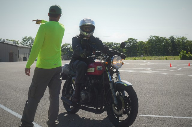 Sean O'Neal instructs Trevor Gerard on how to conduct a tight turn from a stopped position at the Army Traffic Safety Training Program's training site at Fort Knox.