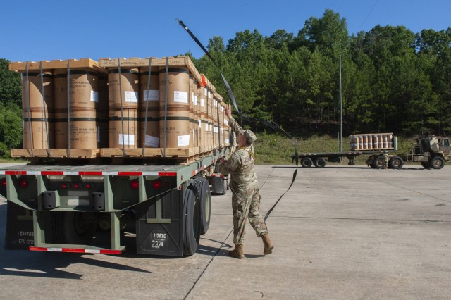 Spc. Orlando Rodriguez works to tie down pallets of munitions prior to conveying them to one of the Anniston Munitions Center's igloos. The 266th Ordnance Company out of Puerto Rico transports and stores munitions in ANMC's igloos at Anniston Army Depot as part of Patriot Bandoleer 2019, a training mission enhancing the readiness of Army forces by pairing Reserve Component units with munitions centers which can utilize their transportation and ordnance experience.