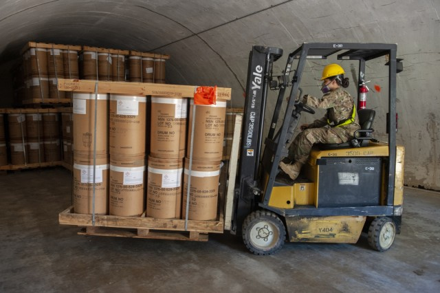 Pvt. Veronica Rodriguez stores munitions in an Anniston Munitions Center igloo. The 266th Ordnance Company out of Puerto Rico transports and stores munitions in the Anniston Munitions Center's igloos at Anniston Army Depot as part of Patriot Bandoleer 2019, a training mission enhancing the readiness of Army forces by pairing Reserve Component units with munitions centers which can utilize their transportation and ordnance experience.