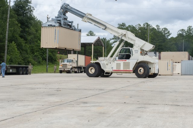 Spc. Jose Gonzalez from the 266th Ordnance Company out of Puerto Rico removes a shipping container using a Terex crane. The 266th Ordnance Company is part of Patriot Bandoleer 2019, receiving, transporting and storing munitions in Anniston Munitions Center's igloos at Anniston Army Depot.