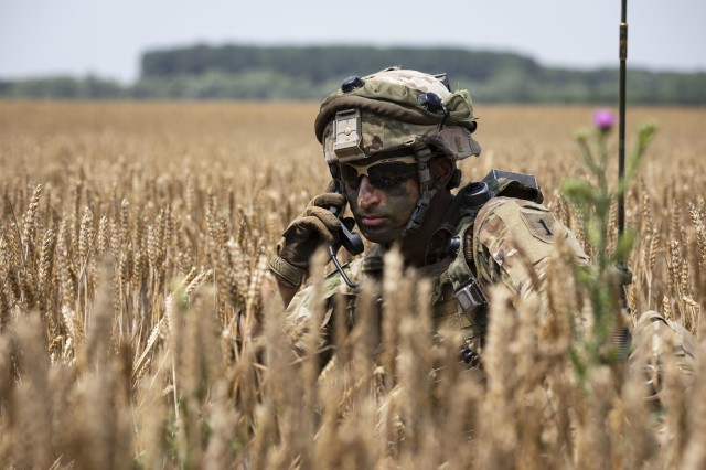An infantryman with 1st Battalion, 16th Infantry Regiment, 1st Armored Brigade Combat Team, 1st Infantry Division, calls up a status report during an air assault mission at Saber Guardian 19, June 20, 2019. Exercises such as Saber Guardian 19, continue to increase participating nations' readiness and capacity to conduct full spectrum military operations. They send a clear message that the U.S. and its allies and partners work skillfully together. (U.S. Army photo by Sgt. Thomas Mort)