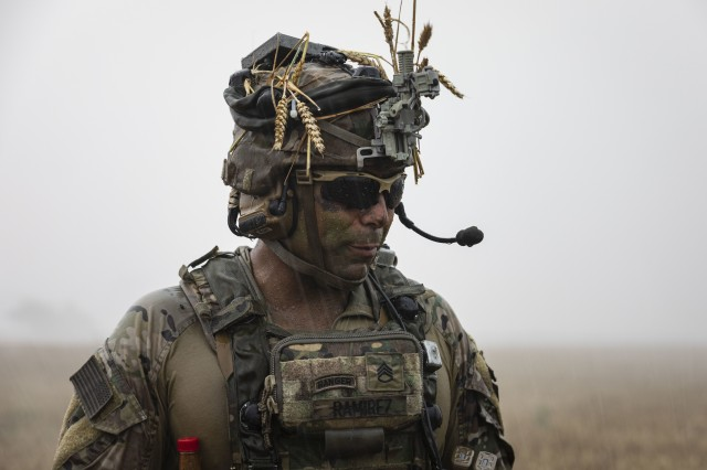 Staff Sgt. Mark Anthony Ramirez, platoon sergeant with 1st Battalion, 16th Infantry Regiment, 1st Armored Brigade Combat Team, 1st Infantry Division, looks toward his squad during an air assault mission at Saber Guardian 19, June 20, 2019. Exercises such as Saber Guardian 19, continue to increase participating nations' readiness and capacity to conduct full spectrum military operations. They send a clear message that the U.S. and its allies and partners work skillfully together. (U.S. Army photo by Sgt. Thomas Mort)