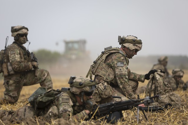 Infantrymen with 1st Battalion, 16th Infantry Regiment, 1st Armored Brigade Combat Team, 1st Infantry Division, take position near a simulated enemy filled trench during an air assault mission at Saber Guardian 19, June 20, 2019. Exercises such as Saber Guardian 19, continue to increase participating nations' readiness and capacity to conduct full spectrum military operations. They send a clear message that the U.S. and its allies and partners work skillfully together. (U.S. Army photo by Sgt. Thomas Mort)