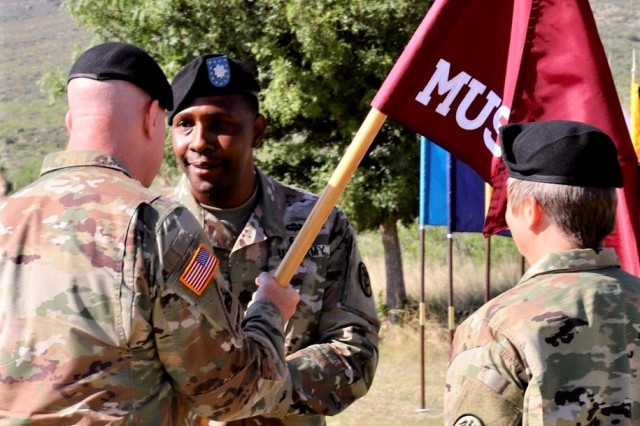 Col. Erik Rude (left), Commander of William Beaumont Army Medical Center, passes the unit flag to Lt. Col. Aaron Braxton II, signifying him as new commander for McAfee U.S. Army Health Clinic.
