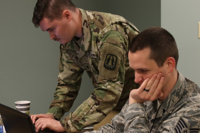 U.S. Army Spc. Cody Bernardy, assigned to the Army Reserve Cyber Operations Group (ARCOG), North Central Cyber Protection Center, 335th Signal Command (Theater), analyzes network data with an Air Force Tech Sgt. during Cyber X-Games 2019, the annual cyber training event sponsored by the ARCOG, June 15 at Moffett Field, California. X-Games 19 was a five-day exercise held June 7-16 and was hosted by the 63rd Readiness Division. The competition exercise focused on the protection of Department of Defense assets through joint force collaboration and welcomed multinational partners to observe how the U.S. Army Reserve Cyber Force plans and trains. (U.S. Army Reserve photo by Sgt. Erick Yates)