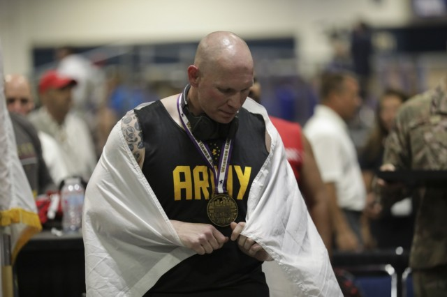 U.S. Army Sgt. 1st Class Joseph Fontenot recevices third place medal for Indoor Rowing June 25, 2019 at the Tampa Convention Center. Competitors practice in preparation for the Department of Defense Warrior Games June 17, 2019 on MacDill Air Force Base. The DOD Warrior Games are conducted June 21-20, hosted by Special Operations Command, Tampa, FL. It is an adaptive sport competition for wounded, ill, and injured service members and veterans. Approximately 300 athletes representing teams from Army, Marine Corps, Navy, Air Forces, Special Command, United Kingdom Armed Forces, Australian Defense Force. Canadian Armed Force of the Netherlands, and the Danish Armed Forces will compete in archery, cycling, shooting, sitting volleyball, swimming, track, field, wheelchair basketball, indoor rowing, powerlifting, and for the first time in Warrior Games history, golf, wheelchair tennis, and wheelchair ruby. (U.S. Army Photo by Spc. Evens Milcette Jr.)
