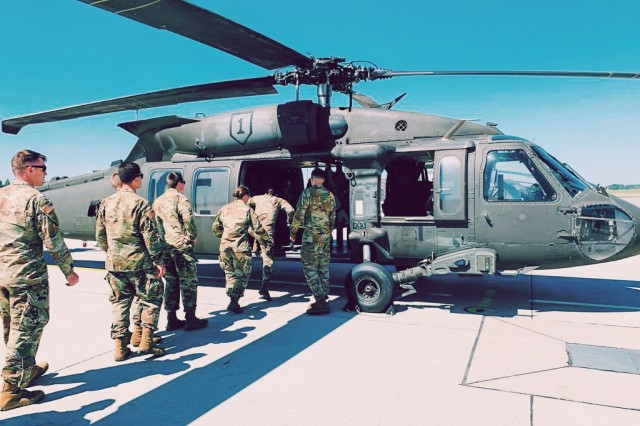 Team three enters a Black Hawk during their visit to Lielv�rde Air Base on June 4. Cadets visited Lielv�rde Air Base to learn about the force, structure and capabilities of the Latvian Air Force.