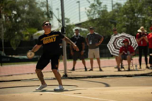 U.S. Army Capt. David Espinoza participates in standing discus during the field competition, June 23, 2019 at the University of South Florida Track and Field Complex, during the 2019 Department of Defense Warrior Games in Tampa, Florida. Approximately 300 athletes representing teams from the Army, Marine Corps, Navy, Air Force, Special Operations Command, United Kingdom Armed Forces, Australian Defence Force, Canadian Armed Forces, Armed Forces of the Netherlands, and the Danish Armed Forces are participating in 13 events throughout the competition. (U.S. Army photo by Staff Sgt. Michael Loggins)