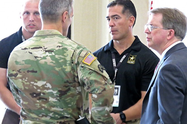 Army Gen. Richard D. Clarke, commander, U.S. Special Operations Command, left, speaks with Team Army physical therapist Luis Cortez and acting Deputy Secretary of Defense, Mr. David L. Norquist on June 22, 2019 during a visit to Short Fitness and Sports Center at MacDill AFB. The Warrior Games were established in 2010 as a way to enhance the recovery and rehabilitation of wounded, ill and injured service members and expose them to adaptive sports. The 2019 DoD Warrior Games are comprised of more than 300 service member and veteran athletes representing the U.S. Army, Marine Corps, Navy, Air Force, Special Operations Command, and five partner nations. (U.S. Army Photo by Joseph Jones)