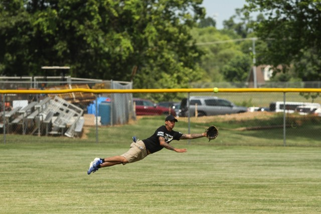 A Screaming Eagle Soldier dives for the ball during the Annual Tobacco Stick Softball Game June 1, 2019, in Clarksville, Tennessee. This is the 10th year the game has been played between the 101st Airborne Division (Air Assault) and Clarksville-Montgomery County government employees. U.S. Army Photo by Spc. Jeremy Lewis.